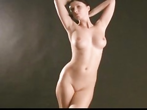 Marvelous nude honey is posing on porno video coating her body in oil