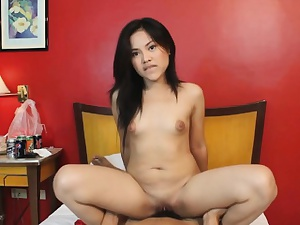 Asian cutie rides dick